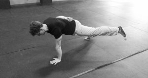 Train the one-arm one-leg push-up for a heavier military press