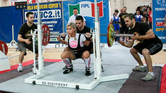 Performing the squat at the national powerlifting competition.