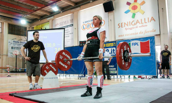Performing the deadlift at the national powerlifting competition.
