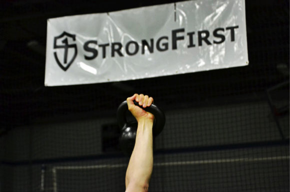 StrongFirst banner and kettlebell