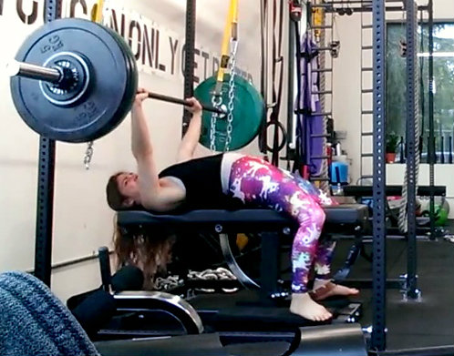 Melody Schoenfeld works at a bigger bench press