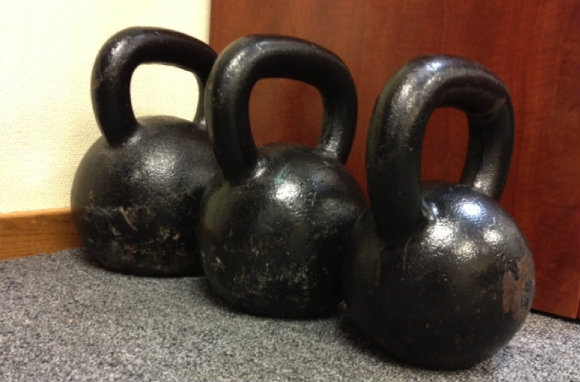 Kettlebells standing by to quickly turn my office into my gym.