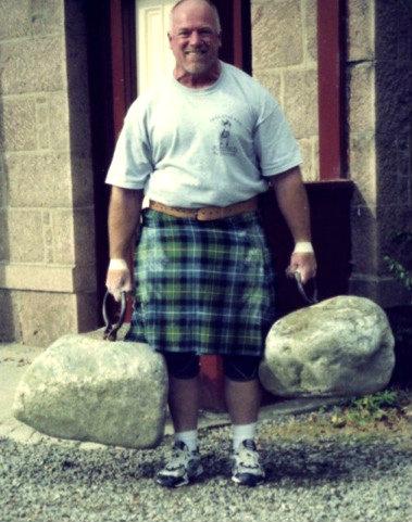 Man lifting Dinnie stones