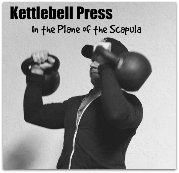 Kettlebell press in the plane of the scapula