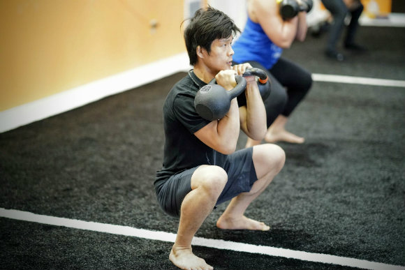 Deep Double Kettlebell Squat