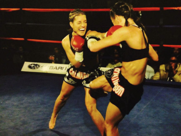 When you fall forward throwing a punch, you can't block the counter. In this case, my low kick landed on my opponent's thigh after I fell forward. (I'm on the right.)