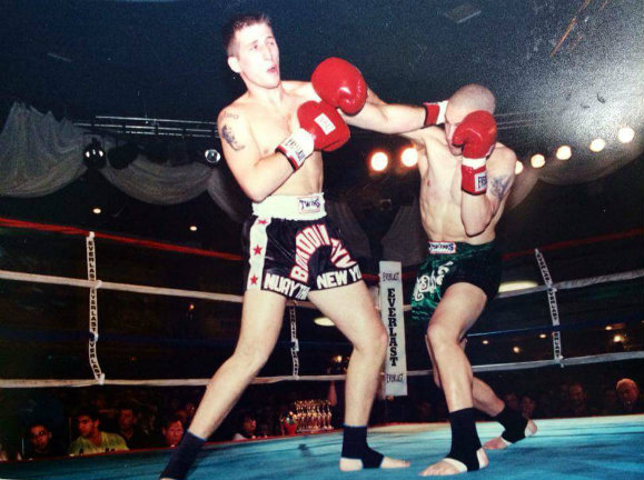 Steve Milles, in the green shorts, demonstrating the cross and a perfect example of rooting, driving off the back foot, and not falling into the opponent.