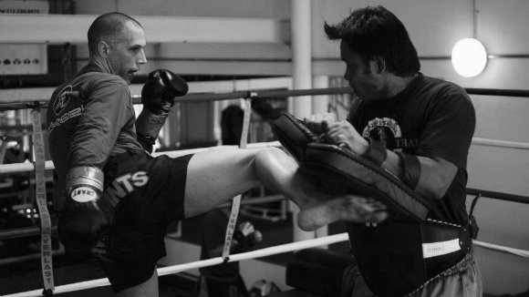 Steve Miles training pads in the gym.