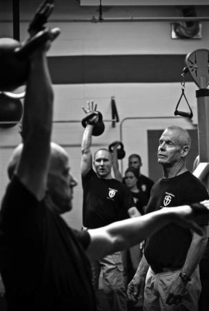 Cole Summers coaching kettlebell students