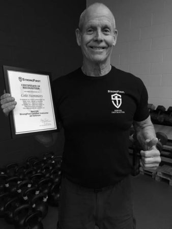Cole Summers with certificate