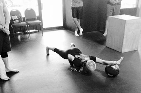 Karen Smith performing the assisted one-arm pushup