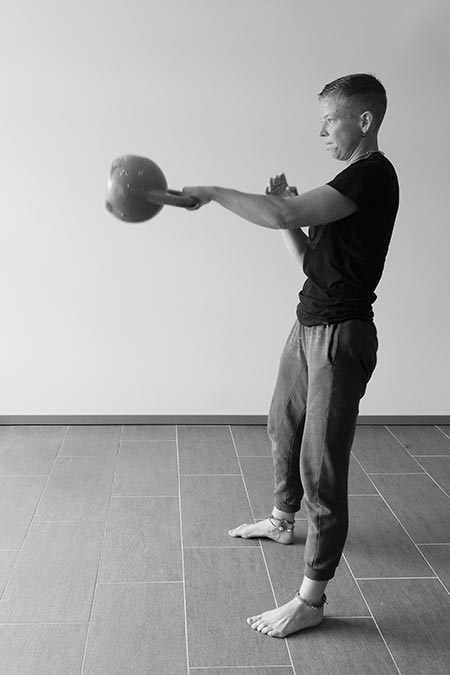 Malou performing the one-arm kettlebell swing