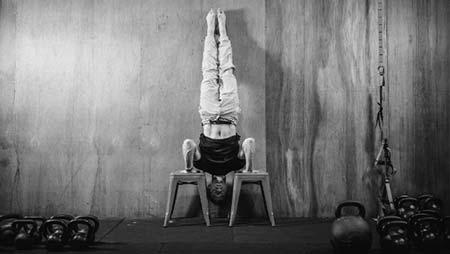 Aleks Salkin performing the handstand pushup