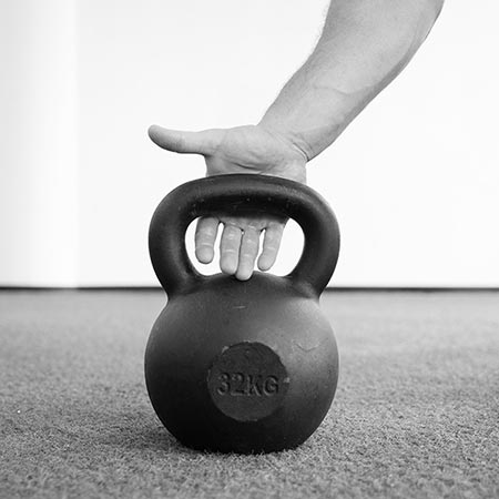 Kettlebell handle placement on the little finger pressure point will reinforce your overhead lockout position