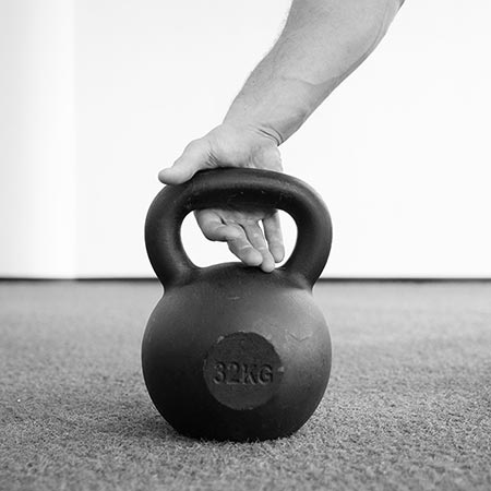Kettlebell handle placement on the thumb pressure point is less than optimal for full overhead lockout