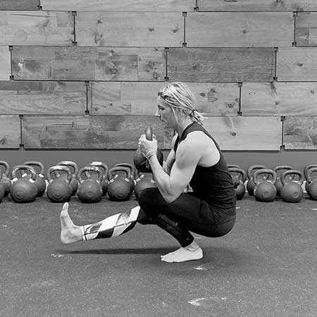 Jackie Vazquez performing the kettlebell pistol squat