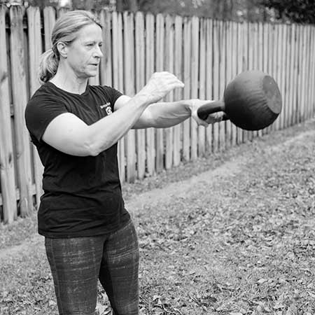 Anna Cannington performing the one-arm kettlebell swing