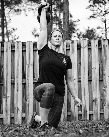Anna Cannington performing the get-up half kneeling