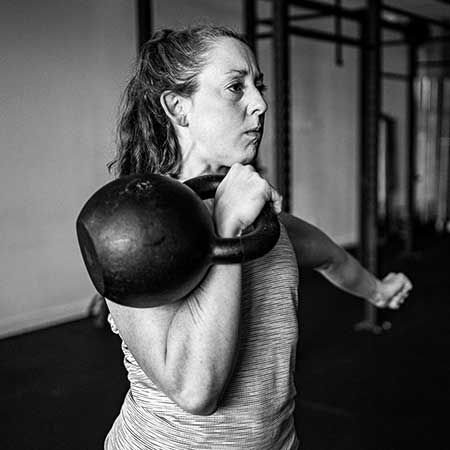 Catherine Buck Le performing the rack hold with a heavy kettlebell