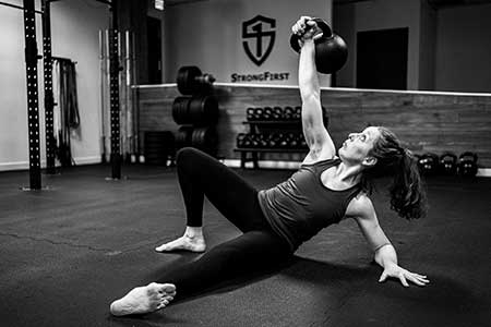 Catherine Buck Le performing the kettlebell get-up