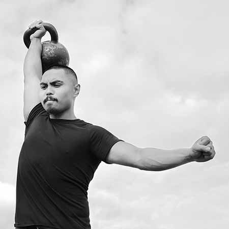 De Leon performing the kettlebell military press