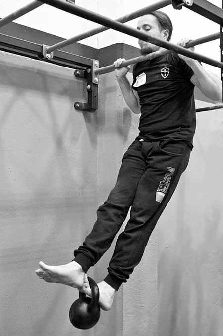 A candidate performing the weighted tactical pullup