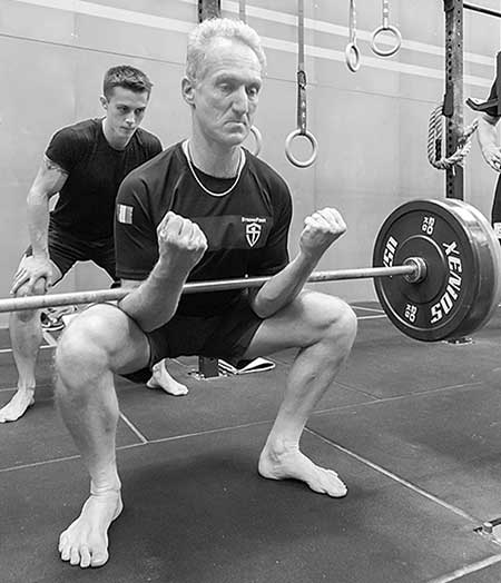 A candidate performing the Zercher squat